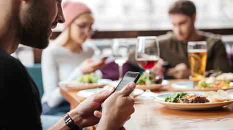 Man enjoying his food at a restaurant