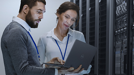 Man and woman consulting while looking at a laptop screen