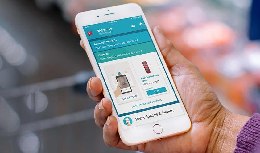 Image of someone holding their phone and looking at Walgreens information